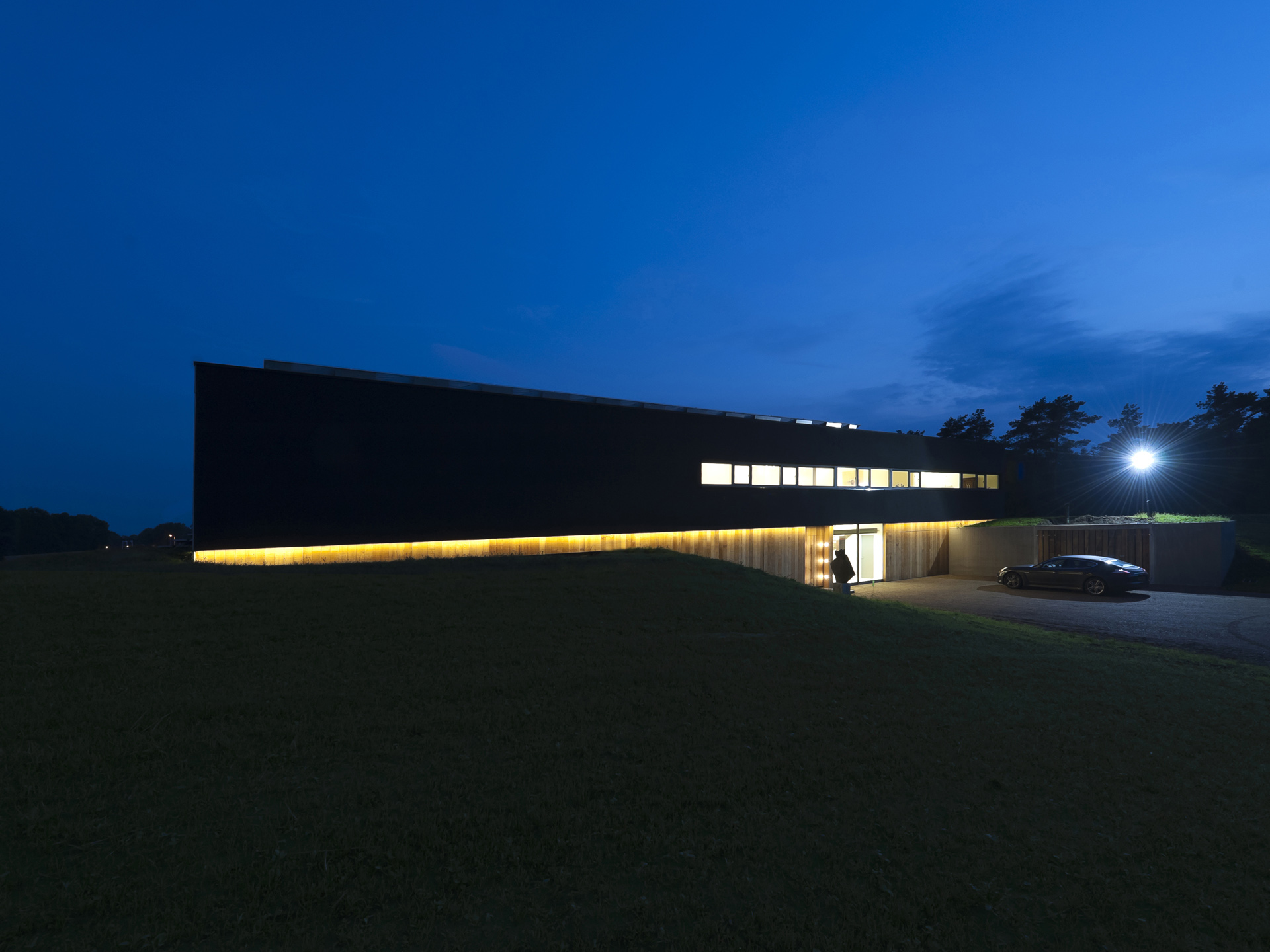 The front facade, with 37 meters of atmospheric lighting