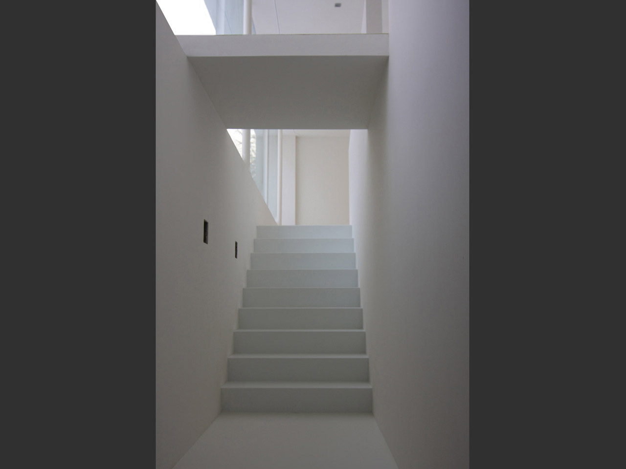 The stairway leading from the underground garage into the living area