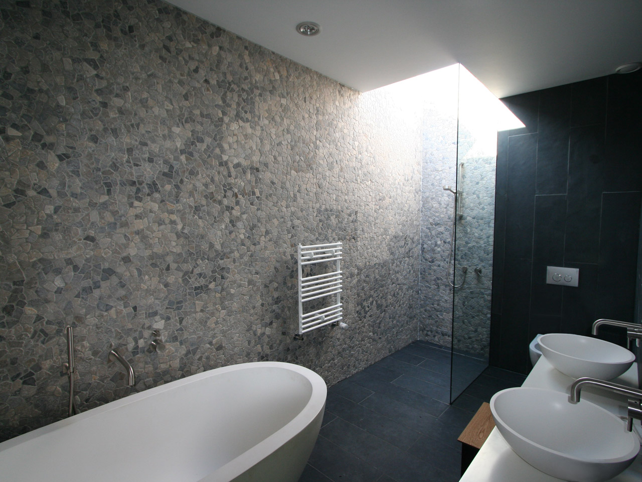 Bathroom with a natural ambience and sky light